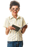 Smiling teen in glasses reading paper book Royalty Free Stock Image
