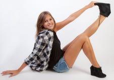 Smiling Teen Grabbing Foot royalty free stock photo