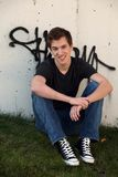 Smiling teen guy and graffitti Royalty Free Stock Photos