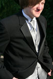 Smiling Teen With Hands In Pockets Of Tuxedo Royalty Free Stock Photo