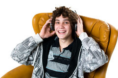 Smiling teen listening to music Royalty Free Stock Image