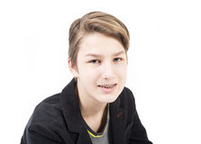 Smiling teen with orthodontic braces. Portrait of beautiful smiling teen boy with orthodontic braces isolated on white background. Concept of emotions Royalty Free Stock Image