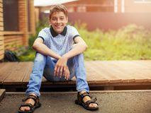 Smiling teen outdoors at summer. Happy one boy royalty free stock image