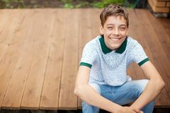 Smiling teen outdoors at summer royalty free stock photography