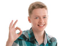Smiling teen showing ok sign Royalty Free Stock Photo