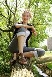 Smiling teen in a tree Royalty Free Stock Photography