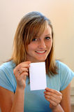Smiling teen with white card Stock Photos