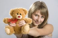 Smiling teen young woman. Holding a teddy bear toy stock image
