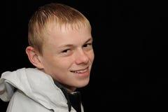 Smiling teenage boy Stock Photos