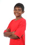 Smiling teenage boy arms folded in studio Royalty Free Stock Images