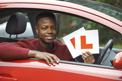 Smiling Teenage Boy In Car Passing Driving Exam Stock Photography