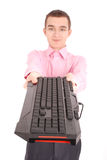 Smiling teenage boy with computer keyboard Royalty Free Stock Photo