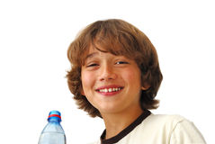 Smiling Teenage Boy After Drinkng Water. Smiling teenage boy after drinking water isolated on white background Stock Photo