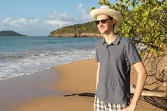 Portrait of smiling teenage boy enjoying view at `Plage de la Perle` in Guadeloupe island, Caribbean. royalty free stock photo
