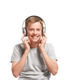 Smiling teenage boy listening to music Stock Photography
