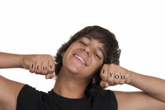 Smiling teenage boy in love. On white background Stock Photos