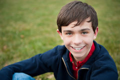 Smiling teenage boy outside royalty free stock photos