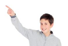 Smiling teenage boy of thirteen indicating something Stock Photography