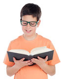 Smiling teenage boy of thirteen reading a book Stock Photography