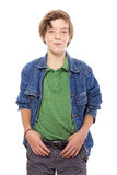 Smiling teenage boy with thumbs in his belt, isolated on white Royalty Free Stock Photography