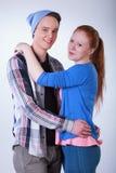 Smiling teenage couple hugging Stock Photography