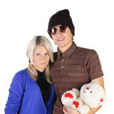 Smiling teenage couple with  toy bear Stock Photography