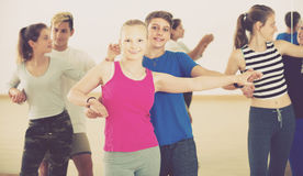 Smiling teenage couples dancing of partner dance Stock Photo