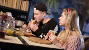 Smiling teenage friends at breakfast in cafe Stock Photography
