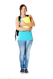 Smiling teenage girl with backpack holding notes . Royalty Free Stock Images