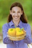 Smiling teenage girl with basket Royalty Free Stock Photo