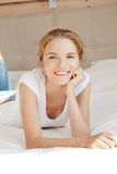 Smiling teenage girl on a bed Royalty Free Stock Image