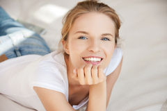Smiling teenage girl on a bed Stock Image
