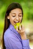 Smiling teenage girl biting Royalty Free Stock Photo