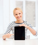 Smiling teenage girl with blank tablet pc screen Royalty Free Stock Images