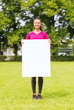 Smiling teenage girl with blank white board Royalty Free Stock Photography