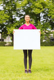 Smiling teenage girl with blank white board Stock Images