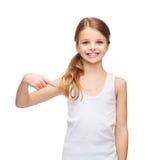 Smiling teenage girl in blank white shirt Royalty Free Stock Photos
