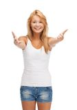 Smiling teenage girl in blank white t-shirt Royalty Free Stock Image