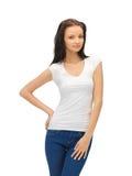 Smiling teenage girl in blank white t-shirt Stock Photo