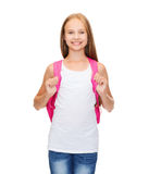 Smiling teenage girl in blank white tank top. Education and school concept - happy and smiling teenage girl in blank white tank top royalty free stock photography