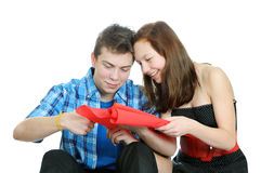 Smiling teenage girl and boy cutting valentine heart out of red paper with scissors Royalty Free Stock Photos