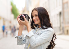 Smiling teenage girl with camera Stock Photos