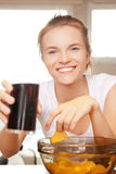 Smiling teenage girl with chips and coke Stock Photo