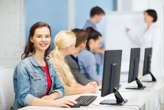 Smiling teenage girl with classmates and teacher Stock Photos