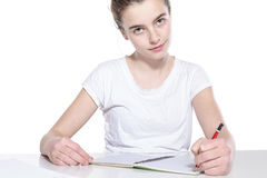 Smiling teenage girl with copy book and pencil Stock Photos