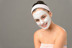 Smiling teenage girl cosmetics mask skin beauty Stock Photo
