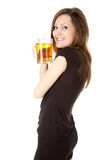 Smiling teenage girl drinking beer from the mug Stock Photography