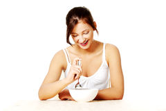 Smiling teenage girl eating. Stock Photo