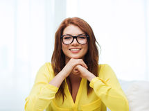 Smiling teenage girl in eyeglasses at home Royalty Free Stock Photo