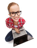 Smiling teenage girl in eyeglasses with laptop Stock Image
